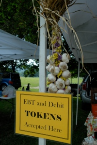 Signs at markets show which vendors accept EBT tokens