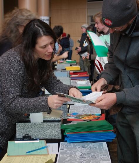 A volunteers helps at registration.