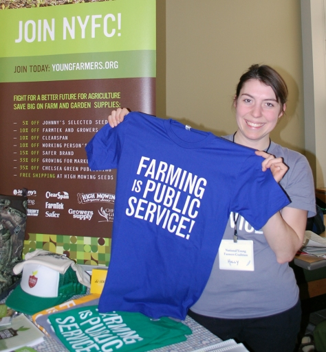 A member of the National Young Farmers Coalition shows some swag in the Exhibitors Hall.