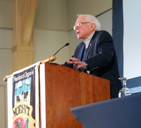 """Sen. Bernie Sanders delights the audience by calling Vermont farmers """"revolutionaries"""" in agriculture."""
