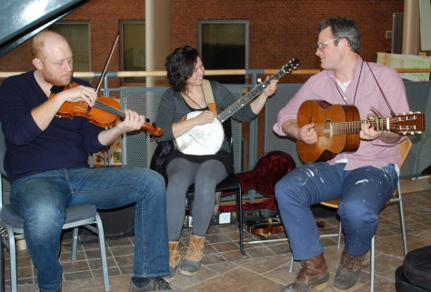 Farmers/fiddlers Caleb Elder, Edith Gawler, and Bennett Konesni played oldtime ballads and hollers, livening up the halls of the conference.