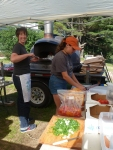 "Jen Miller for RAFFL (Rutland Area Farm & Food Link) and Melissa Weiss of NOFA Vermont work together to churn out dozens of delicious free pizzas for the ""Celebrate Your Farmer"" social at Earth Sky Time Farm on July 16, 2015."