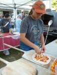 "Melissa Weiss is a summer intern with NOFA and FEED (Food Education Every Day). Here she helps prepare pizzas for the 75 farmers and organic food lovers who attended the ""Celebrate Your Farmer"" pizza social at Earth Sky Time Farm on July 16th, 2015."